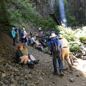 Hikers Enjoying Lunch at Waterfall